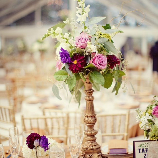 Each centerpiece looked a little different, but they all had vintage accents like this antique candlestick holder.