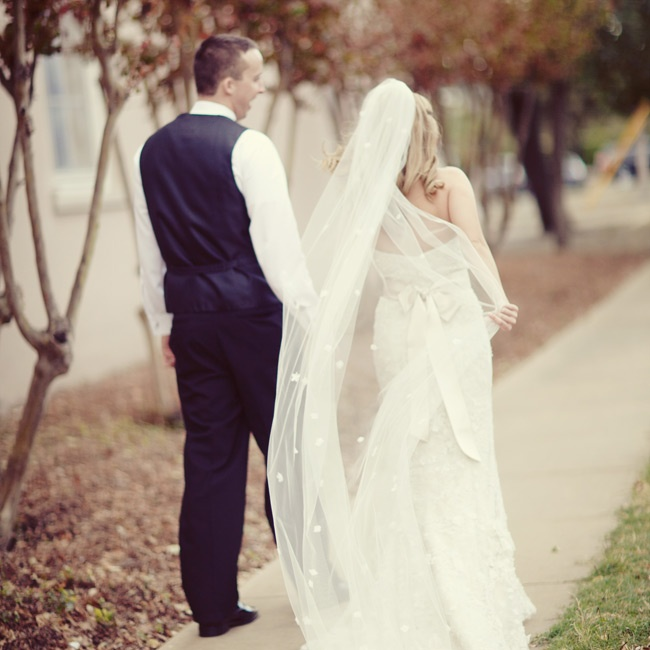 Randi had the extra fabric that came from hemming her dress added to her custom-made veil.