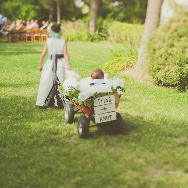 The ring bearer was the bride and groom's eight month old son who was pulled on a decorated red wagon by the flower girl, the bride's niece.