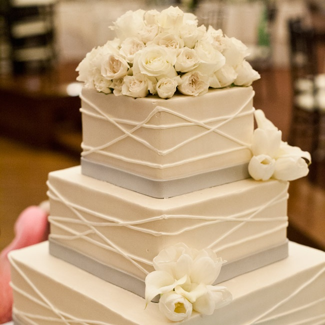 Square tiers and angular piping gave the cake lots of modern style.
