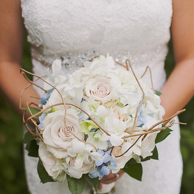 The bride's bouquet consisted of blue and white hydrangeas and white roses with twigs to add some dimension to the bouquet.