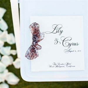 The couple's programs featured a modern twist with a leopard-print chiffon bow finishing it off.