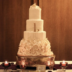 When Chloe found a picture of this cake on-line she fell in love. She had her baker, Gourmet Goodies, re-create the four tier fondant cake which included a bottom tier made of sugar flowers