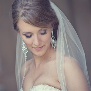 Chloe chose a simple look for her wedding to follow with her classy and elegant theme. She chose purple tones for her eye make-up to complement the bridesmaid's dresses in the pictures.