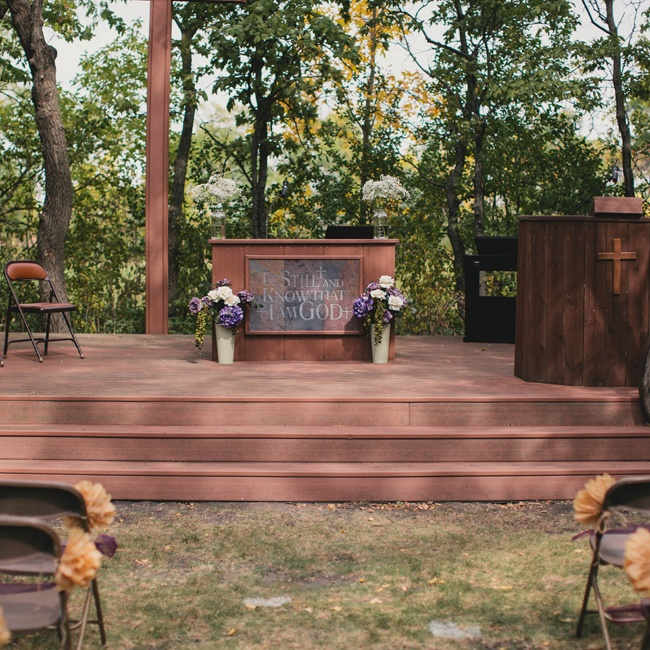 Andrea and David held their ceremony at an outdoor space at the oldest Lutheran Church in North Dakota. The altar sits in a cove of trees and was decorated with two flower arrangements.