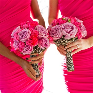 The bridesmaids carried pink and purple roses wrapped with leopard-print fabric.