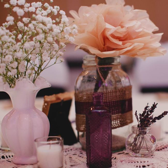 The centerpieces were a collection of mason jars decorated with twine, purple ribbon, pearls, lace and burlap with a collection of white vases filled with baby's breath and clear vases of dried lavender on the outside.