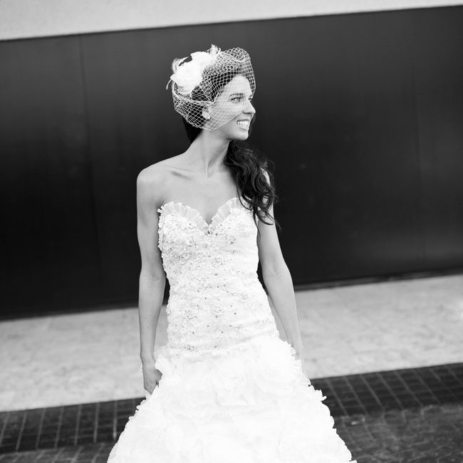 Lily wore a dramatic sparkled dress with a deep sweetheart neckline and ruffled on the bottom. She finished her look with a birdcage veil.