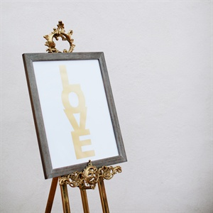 This gold LOVE print sat next to the couple's escort table through the night and now hangs in their kitchen.