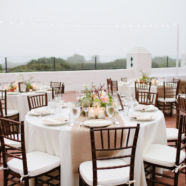 Burlap runners, white linens and wooden chiavari chairs gave the reception an elegant, romantic, yet rustic look.