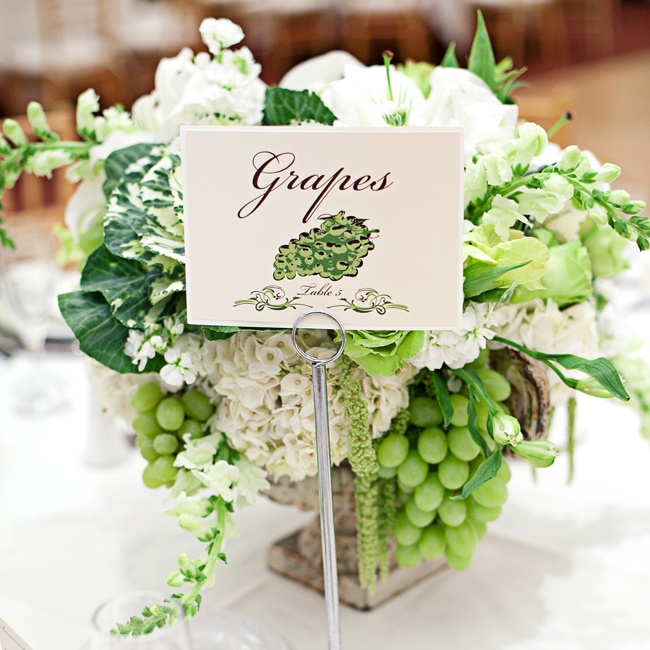 Each table was named after a different fruit and the couple's florist incorporated the particular fruit into the centerpiece, like these green grapes.