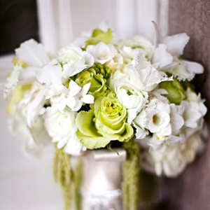 Annemarie carried a white and green gathering of roses, orchids, tulips, stephanotis and amaranthus.