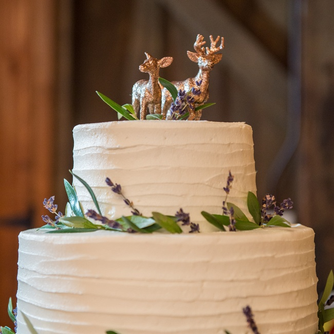 Kathryn and Justin's cake was two tiers with olive branches and  lavender flowers decorating the edges and two glittered deer as the topper. Justin is an avid hunter so to honor his hobby the couple had a subtle buck and doe theme.