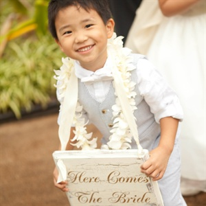 The bride&#39;s nephew, Joseph (they call him JoJo), was the ring bearer. He wore a Here Comes the Bride sign to announce Teresa&#39;s walk down the aisle.