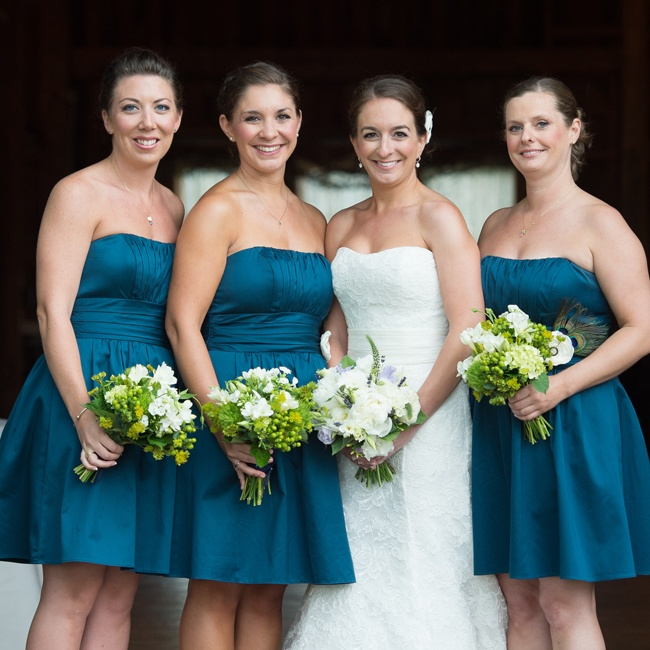Kathryn had two bridesmaids and a maid of honor. All of the girls wore peacock-blue dresses and gold sandals. As a thank you gift for each girl Kathryn gave them all a necklace make with their birthstone and initial, which they wore during the wedding.  To add some interest to the dresses they each wore a silk flower pin that was adorned with peaco ...