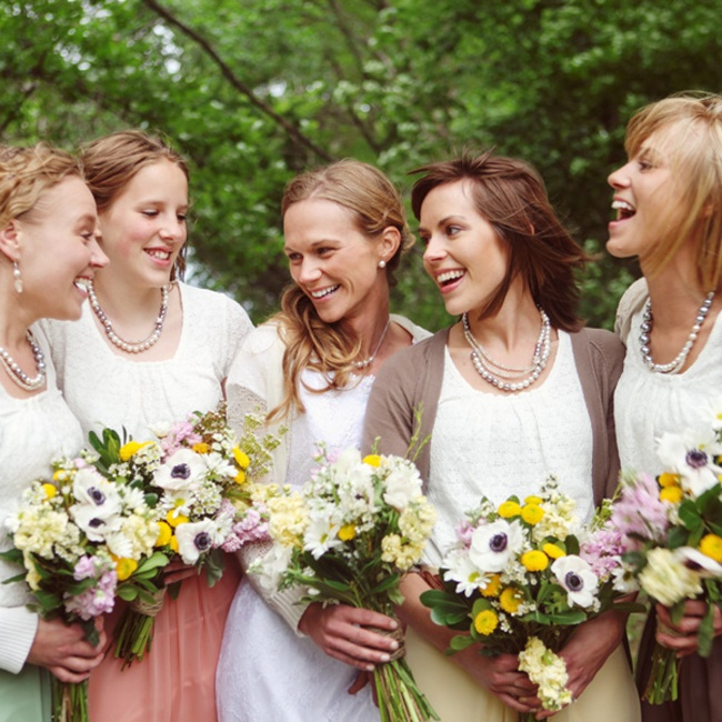 Kim had her four younger sisters as her bridesmaids.  The bridesmaids wore custom made skirts designed by the bride in different colors with white tops. The bridesmaids also wore custom made necklaces by Jeaneen, one of the bridesmaids.