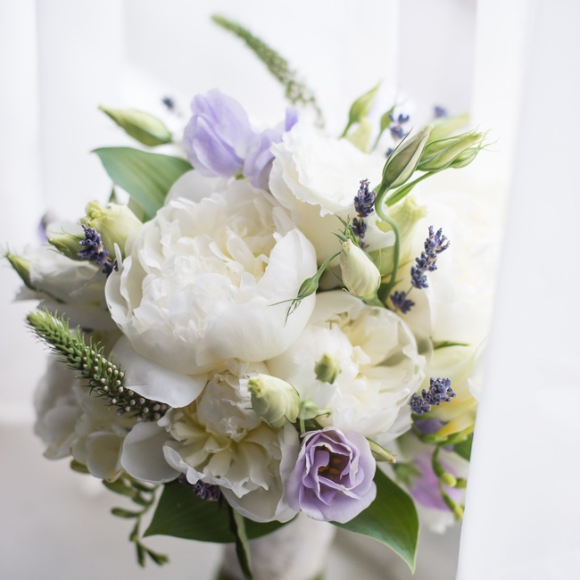 Kathryn's bouquet was made up of all organic flowers in different shades of ivory and purple. The florist chose flowers that were grown locally and in season during the wedding.