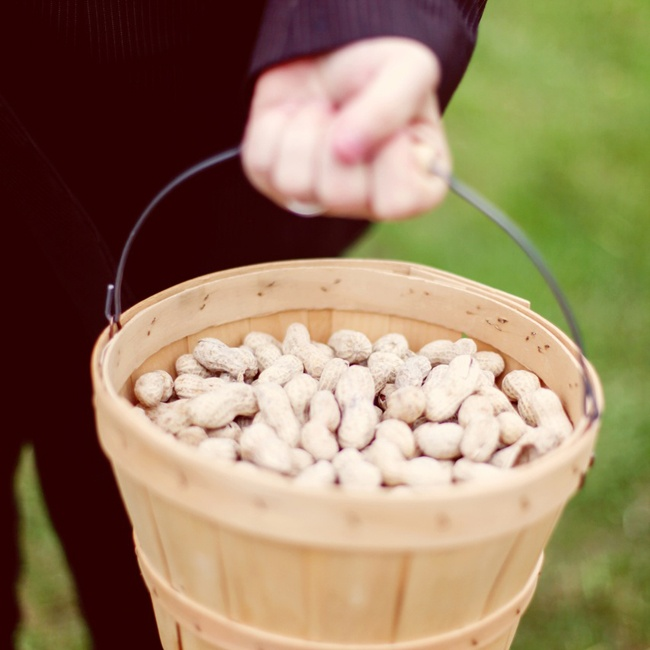 The bride and groom set up baskets filled with peanuts throughout the reception for guests to enjoy.