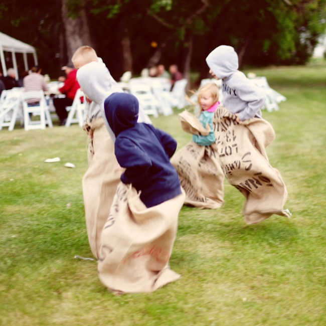 Kim and Tyler had games like bean bag toss and potato sack races at their outdoor wedding.