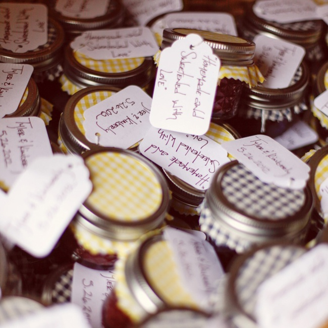 Kim and Tyler's wedding was a collaboration of DIY projects by family and friends. Kim and her mom canned over 100 jars of homemade jam for the wedding favors. The tags were handmade by the bride's sister.