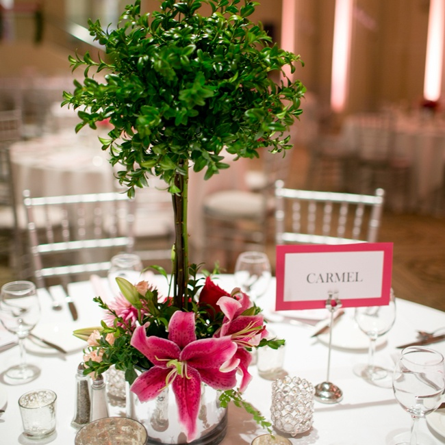 Dana and Matt named the guest tables after places where they had traveled to together over the years leading up to the wedding. They had a couple of different centerpieces for the reception but they all contained Dana's favorite flower the stargazer lily.