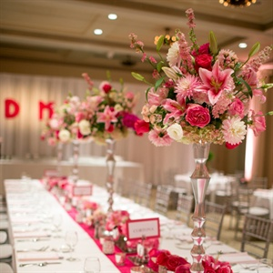 They had both long and round tables and the reception. The tables had white tablecloths and light pink napkins with a pink table runner. The tall centerpieces had an ombre pink color scheme to complete the look.