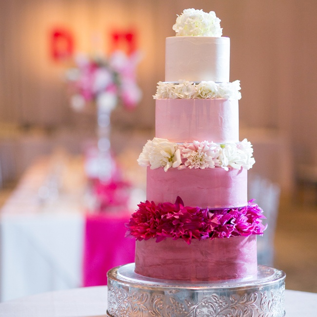 Dana and Matt's wedding cake was a four tier pink ombre cake decorated with dahlias between each layer.