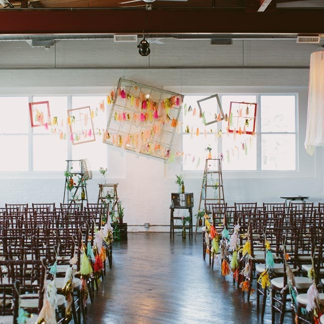 Colorful handmade garlands, frames and windowpanes decorated the space.