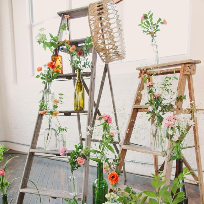 Borrowed ladders and crates, decorated with pink, red and orange flowers, served as a backdrop for the ceremony.