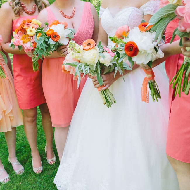 The bridesmaids carried smaller versions of the bridal bouquet. Megan asked them to choose their own dresses in shades of peach and coral.