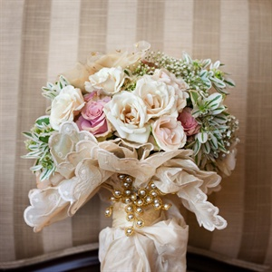 The bride carred roses, silk flowers, snow on the mountain and baby's breath in her soft-hued bunch.