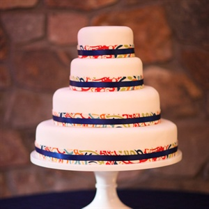 Each tier of the white cake was wrapped with ribbon to match the day's colors.