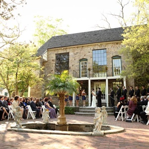 The couple exchanged vows in a courtyard in front of an old stone barn.
