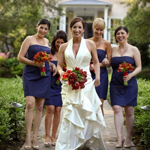 All of the bridesmaids wore the same strapless, short navy-blue dresses.