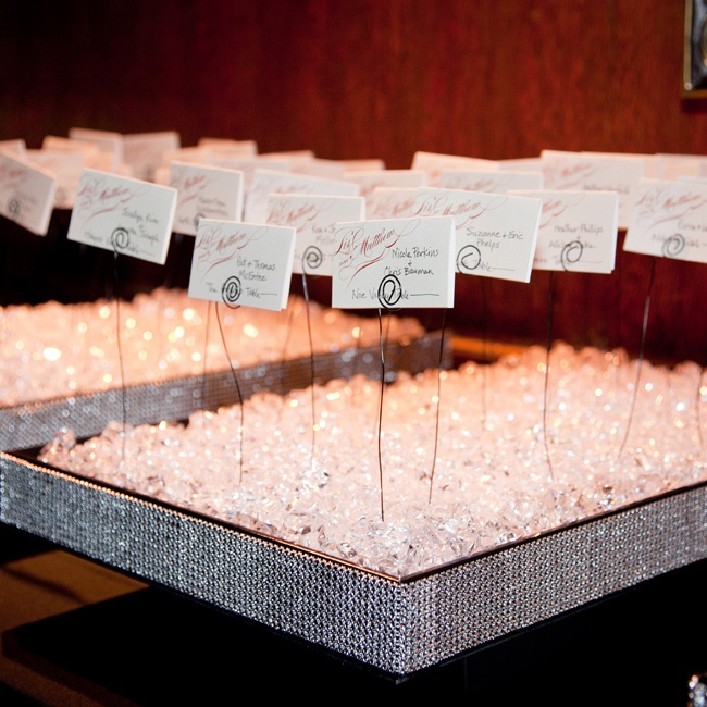 The elegant escort cards were displayed in large boxes filled with hundreds of crystals.
