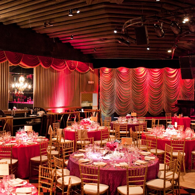 Jewel-toned linens, gold chiavari chairs, bold uplighting and retro draping set the tone the couple was after.