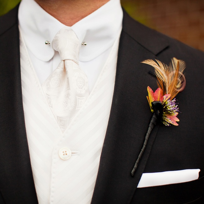 Matt wore a feather and flower boutonniere to contrast against his white vest and tie.
