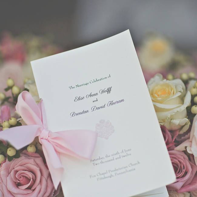 The simple yet sophisticated programs were tied together with pale-pink satin ribbon.
