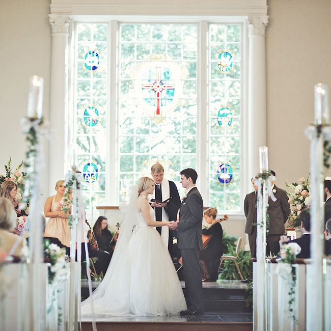 Not wanting to overwhelm the beautiful décor in Elise's childhood church, the couple accented its elegance with roses, ivy and hydrangeas.