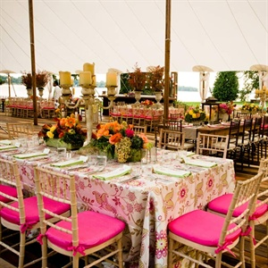 Large wrought-iron candelabras, patterned linens and a multicolored wooden floor added interest.