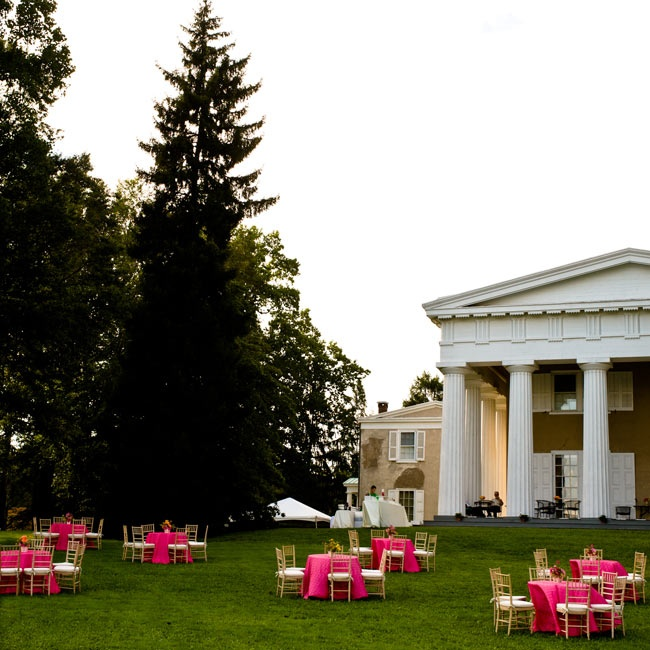 The outdoor cocktail hour was held on the estate's lawn, with tables draped in pink linens.