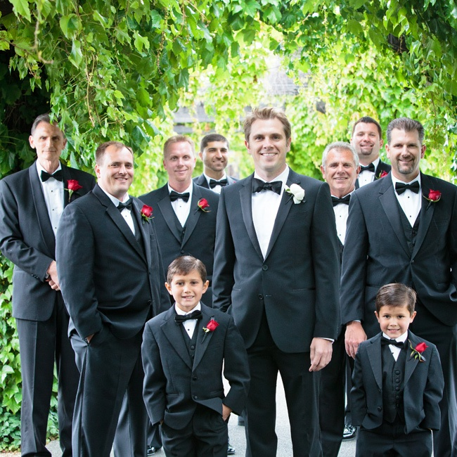 All the guys (including the ring bearers!) wore black tuxedos and bow ties with red rose boutonnieres.