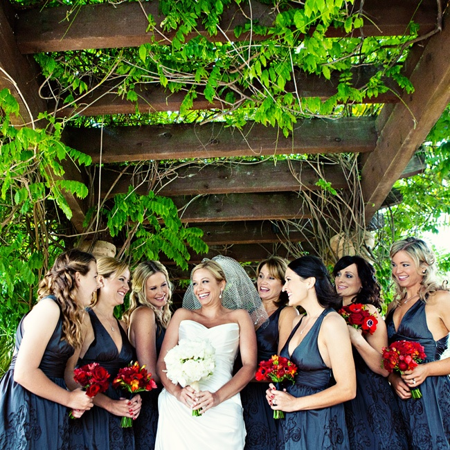 The girls wore halter dresses in dark gray hue with floral detailing on the skirts.