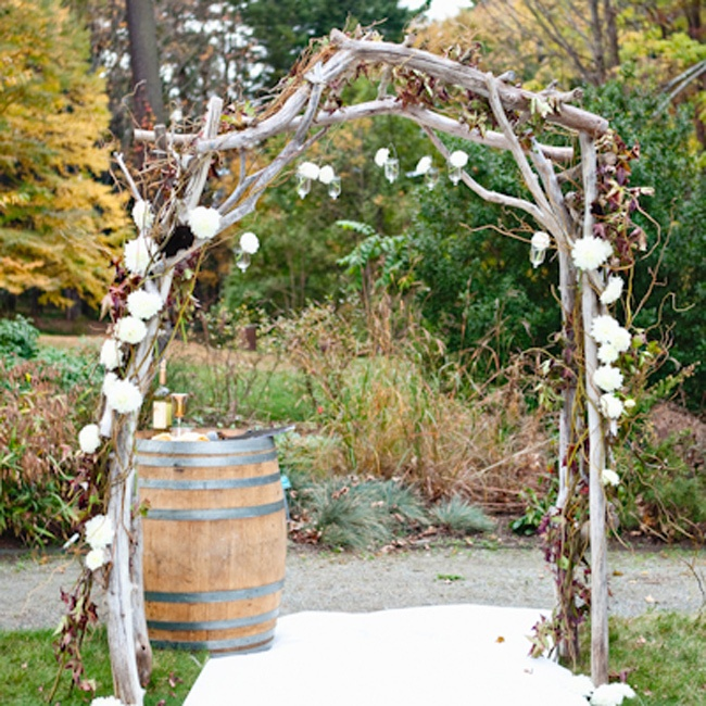 Emily and Bill wed beneath this driftwood and floral-decorated huppah.