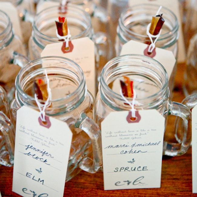 Mason jars filled with honey sticks doubled as guests' escort cards and favors.