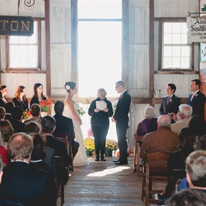 The couple exchanged vows in the hayloft of a historic barn.