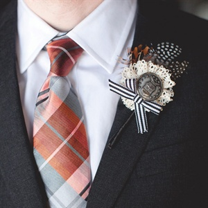 Each guy wore a homemade lace, button, bow and feather boutonniere.