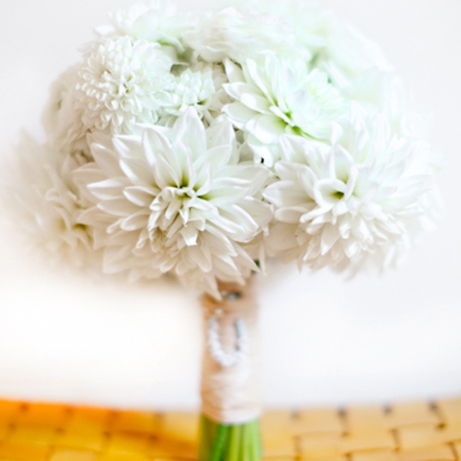 Emily carried an all-white bouquet of different kinds of dahlias.