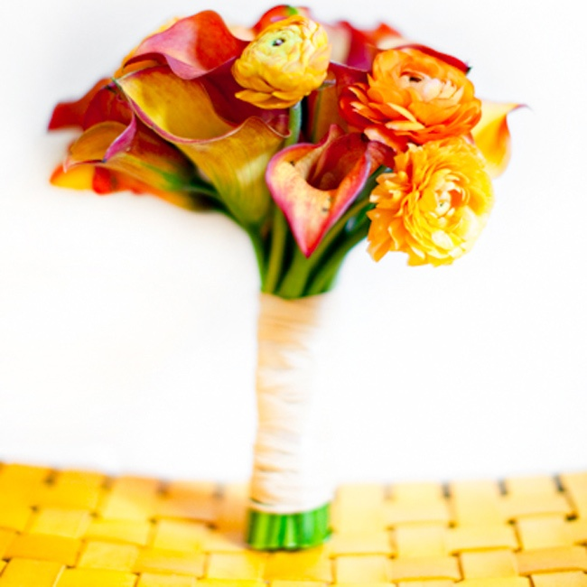 The girls carried vibrant bunches of red, orange and yellow calla lilies and ranunculuses.