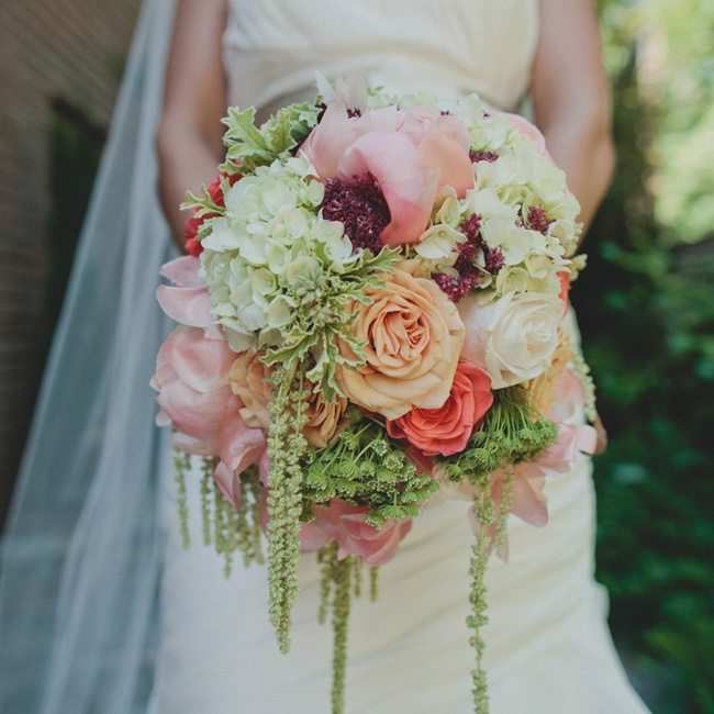 Kelsey carried a bouquet of coral peonys, vandella roses, green hydranda, parrot tulips, and fugi mums.